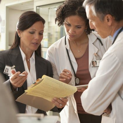 Doctors working with hospital administrator