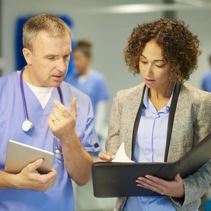 Doctor working with hospital administrator