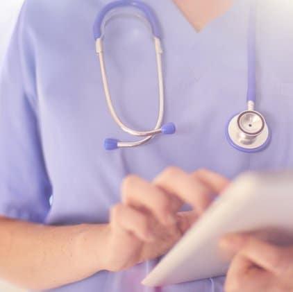 Nurse holding tablet