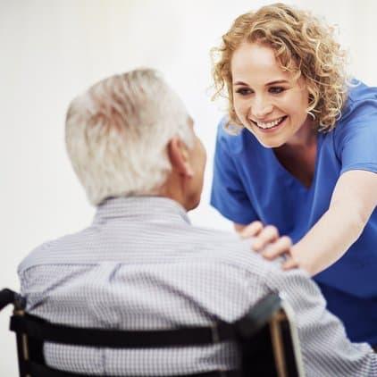 Nurse speaking with man in wheelchair