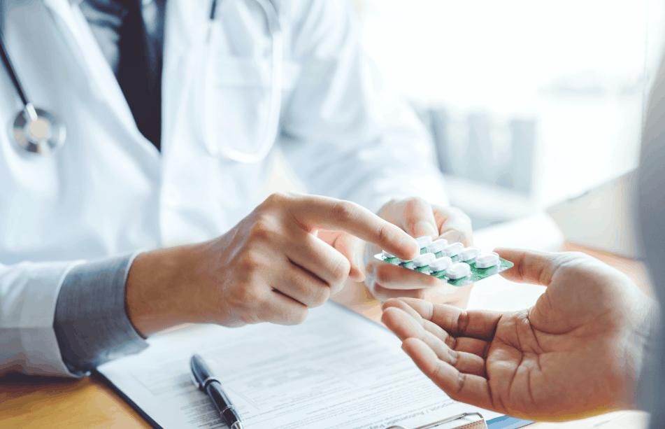 pharmacist holding packet of pills